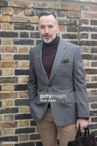 Film director David Furnish wears a Kingsman jacket Drake'u2019s pocket square and Burberry bag on day 4 of London Collections Men on Januay 11 2016...