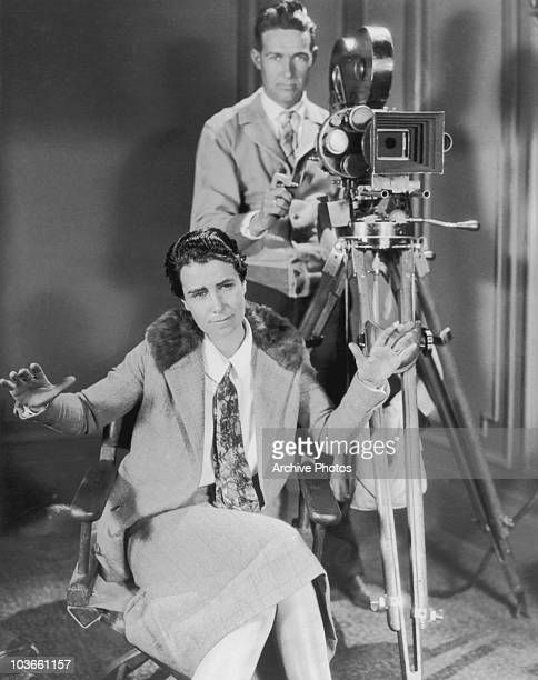 Film director Dorothy Arzner pictured on directing 'Fashions For Women' USA circa 1927 A man operating a camera is seen behind Arzner