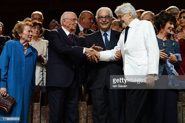 Film Director Ettore Scola is greeted as his wife looks on by President of La Biennale Paolo Baratta Italian Presiden Giorgio Napolitano and his wife...