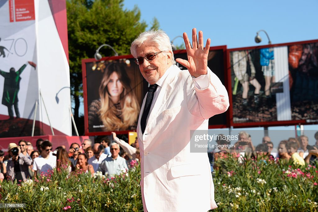 Film Director <a gi-track='captionPersonalityLinkClicked' href=/galleries/search?phrase=Ettore+Scola&family=editorial&specificpeople=2727230 ng-click='$event.stopPropagation()'>Ettore Scola</a> poses on the red carpet before receiving the 'Jaeger-LeCoultre Glory To The Filmmaker 2013 Award' after the 'Che Strano Chiamarsi Federico - Scola Raconta Fellini' Premiere during The 70th Venice Film Festival at Palazzo del Cinema on September 6, 2013 in Venice, Italy.