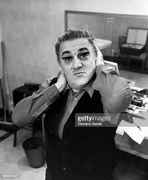 Film director Federico Fellini wears an extreme pair of false eyelashes