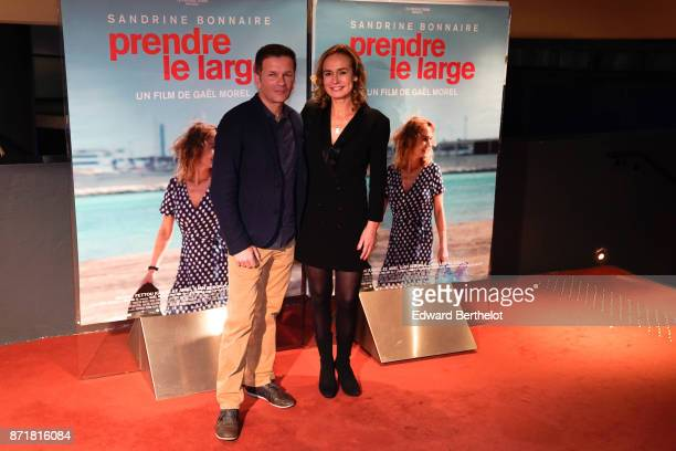 Film Director Gael Morel and French actress Sandrine Bonnaire during the 'Prendre Le Large' Paris Premiere photocall at UGC Cine Cite des Halles on...
