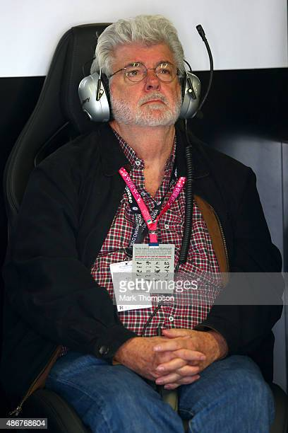 Film director George Lucas sits in the Mercedes GP garage during final practice for the Formula One Grand Prix of Italy at Autodromo di Monza on...
