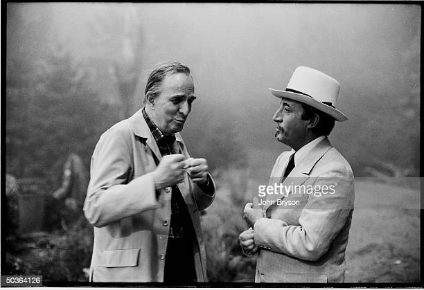 Film director Ingmar Bergman talking with actor Peter Sellers while he visits a movie set during a trip to Hollywood