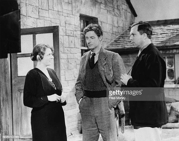 Film director King Vidor talking to actors Dilys Davies and Robert Donat on the set of the film 'The Citadel' at Denham Studios England June 24th 1938