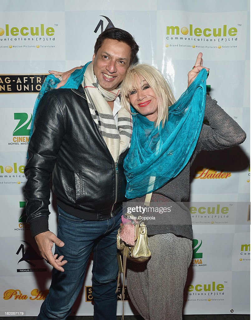 Film director Madhur Bhandarkar (L) and fashion designer Betsey Johnson attend the 'Ticket 2 Bollywood: Cinema Beyond Boundaries' Opening Night Screening at SVA Theater on September 27, 2013 in New York City.