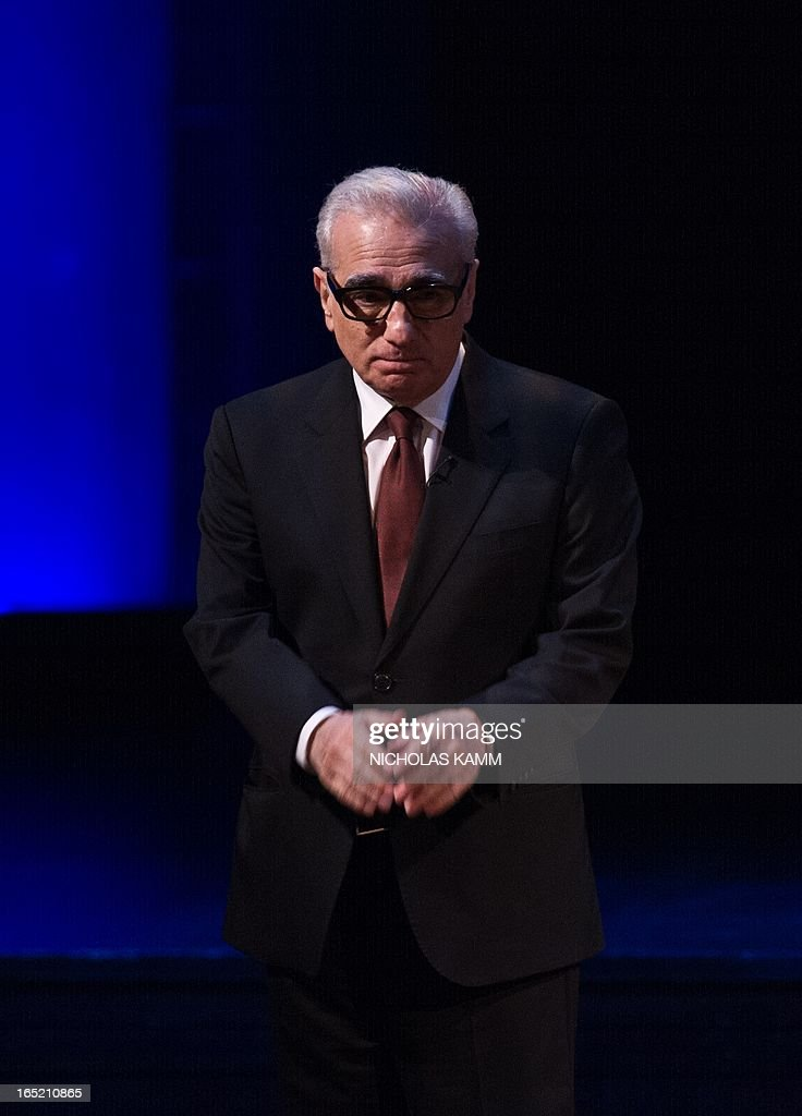 """US film director Martin Scorsese bids farewell to the audience after delivering the 2013 Jefferson Lecture in the Humanities entitled """"Persistence of Vision: Reading the Language of Cinema"""" at the Kennedy Center in Washington on April 1, 2013. AFP PHOTO/Nicholas KAMM"""