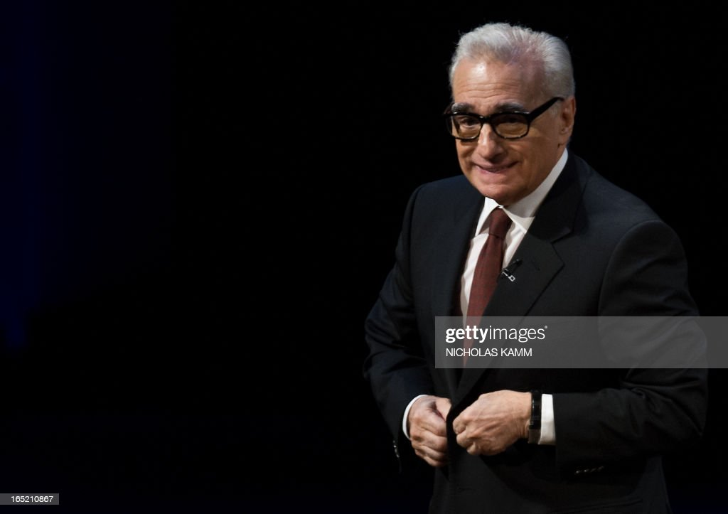 "US film director Martin Scorsese bids farewell to the audience after delivering the 2013 Jefferson Lecture in the Humanities entitled ""Persistence of Vision: Reading the Language of Cinema"" at the Kennedy Center in Washington on April 1, 2013. AFP PHOTO/Nicholas KAMM"