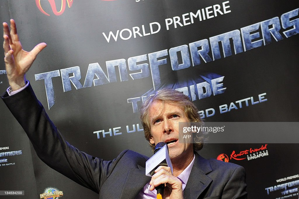 US film director Michael Bay (C) talks during a press conference at a media preview for 'Transformers: The Ride' at Universal Studios Singapore on December 2, 2011. The themed amusement park ride, due to open for the public on December 3, is based on the Transformers movie franchise directed by Bay.