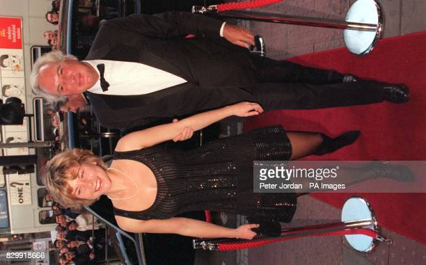 Film director Michael Winnner and friend Vanessa Perry arrive at London's Dominion Theatre this evening for the opening of the Disney musical Beauty...