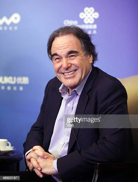US film director Oliver Stone is interviewed during a press conference as part of the 4th Beijing International Film Festival on April 16 2014 in...