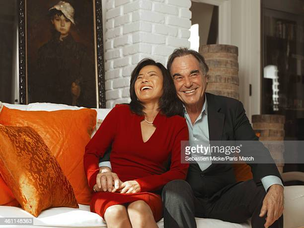Film director Oliver Stone is photographed at home with his wife SunJung for Paris Match on December 4 2013 in Los Angeles California