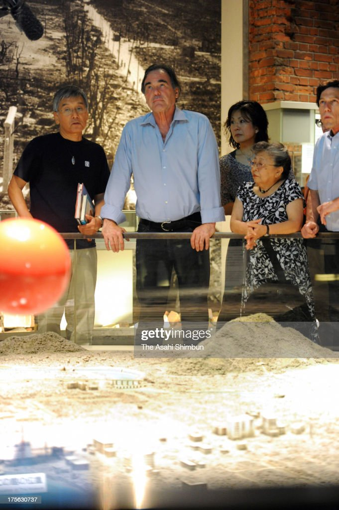 Film Director <a gi-track='captionPersonalityLinkClicked' href=/galleries/search?phrase=Oliver+Stone&family=editorial&specificpeople=173458 ng-click='$event.stopPropagation()'>Oliver Stone</a> (C) visits the Hiroshima Peace Memorial Museum on August 4, 2013 in Hiroshima, Japan. Stone will attend the Peace Memorial on August 6 in Hiroshima and Nagasaki on August 9.