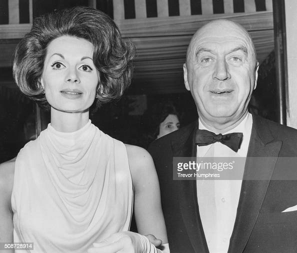 Film director Otto Preminger and his wife Hope attending the premiere of the film 'In Harm's Way' at the Plaza Leicester Square London May 15th 1965
