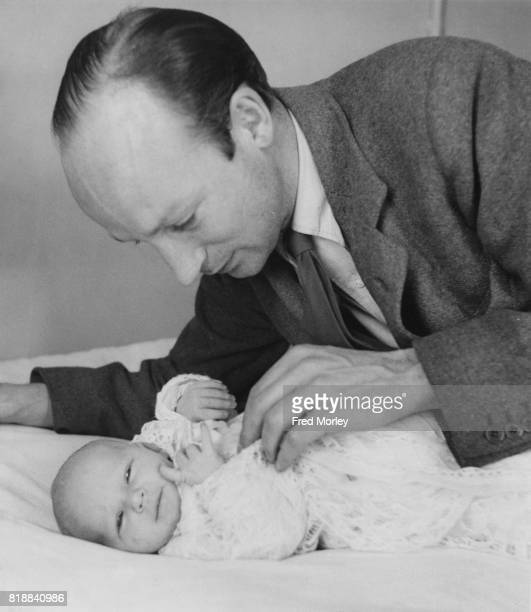 Film director Robert Stevenson with his baby daughter Venetia in a London nursing home 22nd March 1938 Venetia's mother is actress Anna Lee