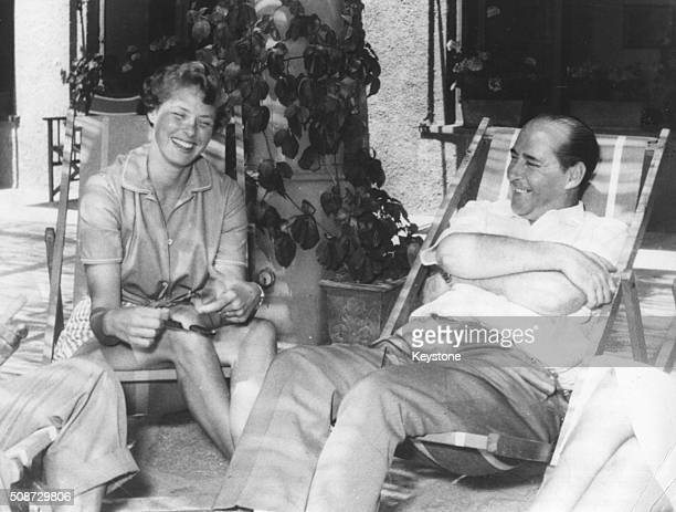 Film director Roberto Rossellini and his wife actress Ingrid Bergman relaxing together in deck chairs in Portofino circa 1952 Printed following his...