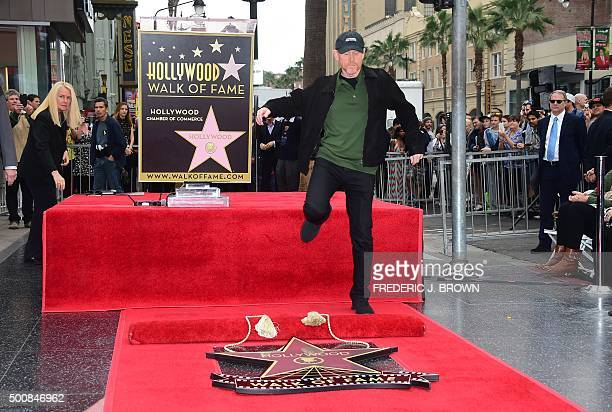 Film director Ron Howard leaps from the podium ahead of the unveiling of his Hollywood Walk of Fame Star in Hollywood California on December 10 2015...