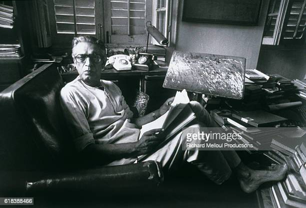 Film director Satyajit Ray reads a movie script in his home office Ray is the preeminent filmmaker of India as well as an internationally acclaimed...