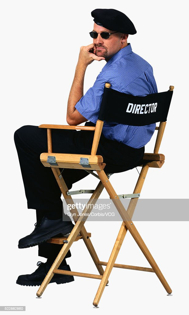 film director sitting in his directors chair stock photo