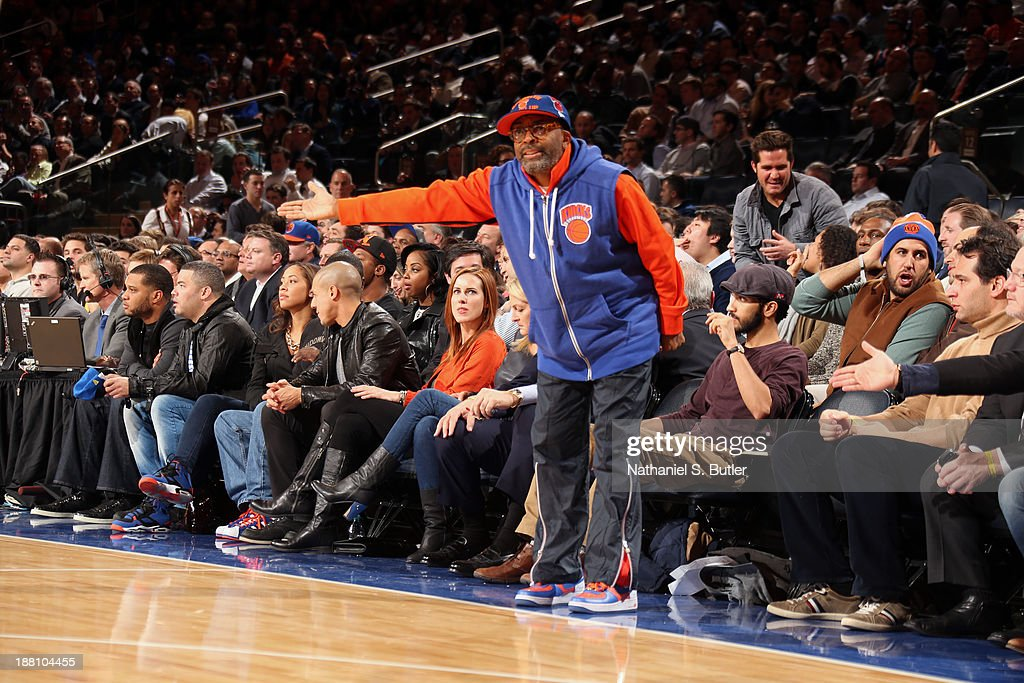 Film director <a gi-track='captionPersonalityLinkClicked' href=/galleries/search?phrase=Spike+Lee&family=editorial&specificpeople=156419 ng-click='$event.stopPropagation()'>Spike Lee</a> communicates with the referees while the New York Knicks play a game against the Houston Rockets at Madison Square Garden in New York City on November 14, 2013.