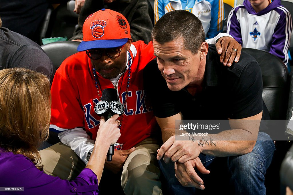 Film director Spike Lee, left, and actor Josh Brolin give an interview on the sidelines of a game between the New York Knicks and New Orleans Hornets on November 20, 2012 at the New Orleans Arena in New Orleans, Louisiana.