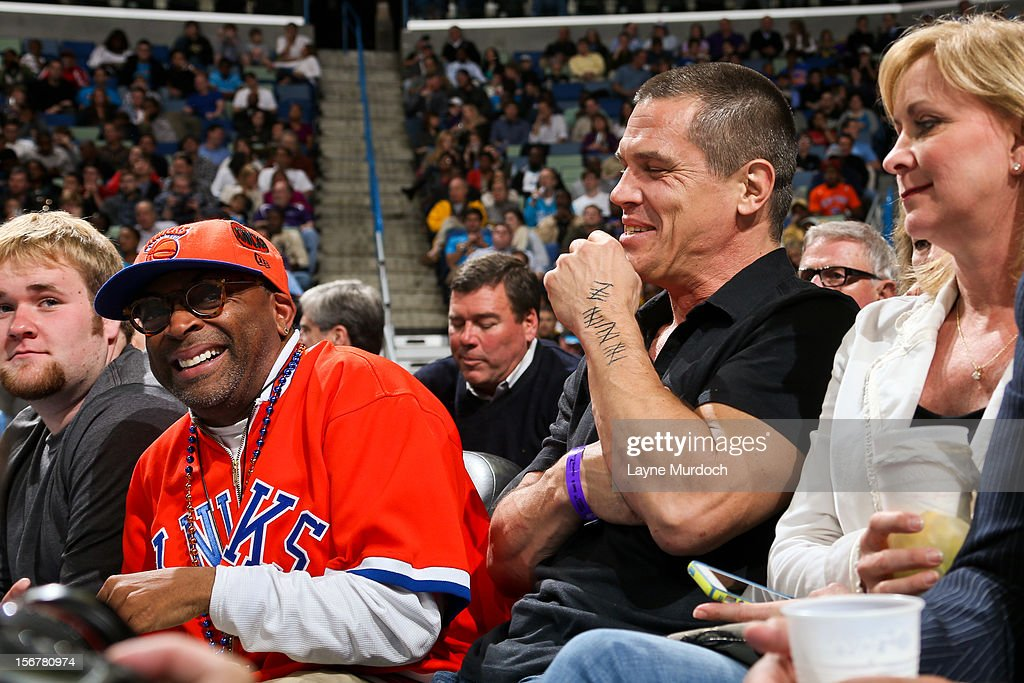 Film director Spike Lee, left, and actor Josh Brolin share a laugh on the sidelines of a game between the New York Knicks and New Orleans Hornets on November 20, 2012 at the New Orleans Arena in New Orleans, Louisiana.