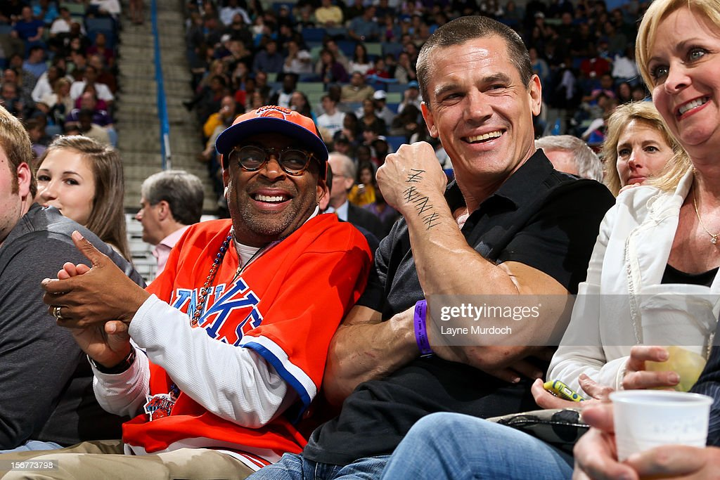 Film director Spike Lee, left, and actor Josh Brolin smile while attending a game between the New York Knicks and New Orleans Hornets on November 20, 2012 at the New Orleans Arena in New Orleans, Louisiana.