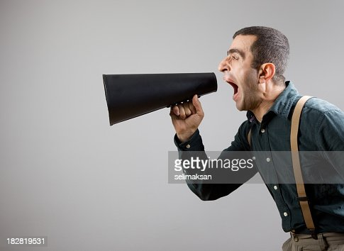 Film Director Wearing Shirt And Suspenders Shouting With Megaphone