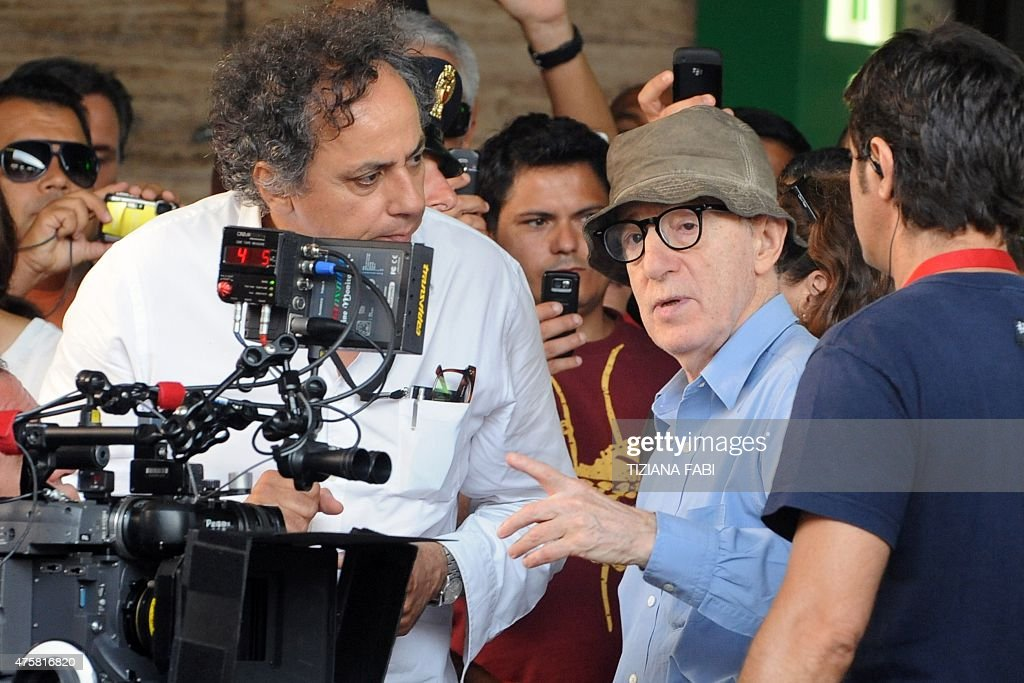 US film director Woody Allen chats with his team on the set of his new film The Bop Decameron at Rome's Termini train station on July 14 2011 The...