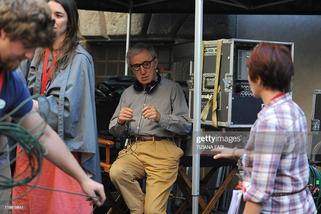 US film director Woody Allen listens to amember of the crew at Piazza della Pace in central Rome during the filming of his new movie The Bop...