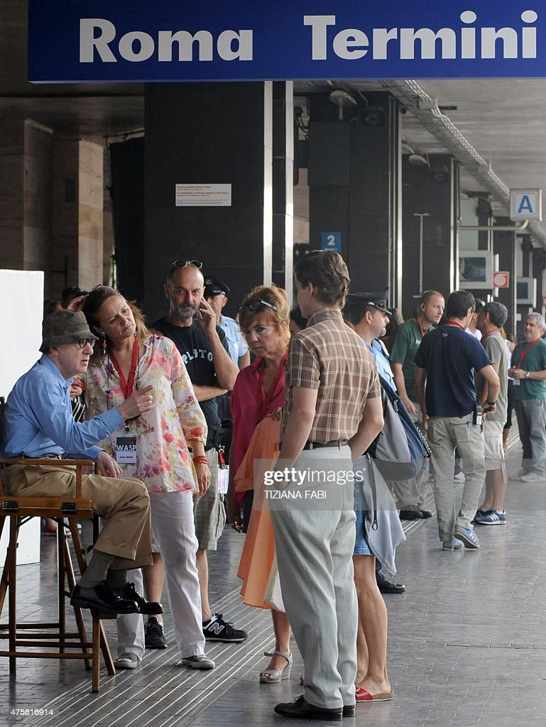 US film director Woody Allen speaks to actors and assistants on the set of his new film The Bop Decameron at Rome's Termini train station on July 14...