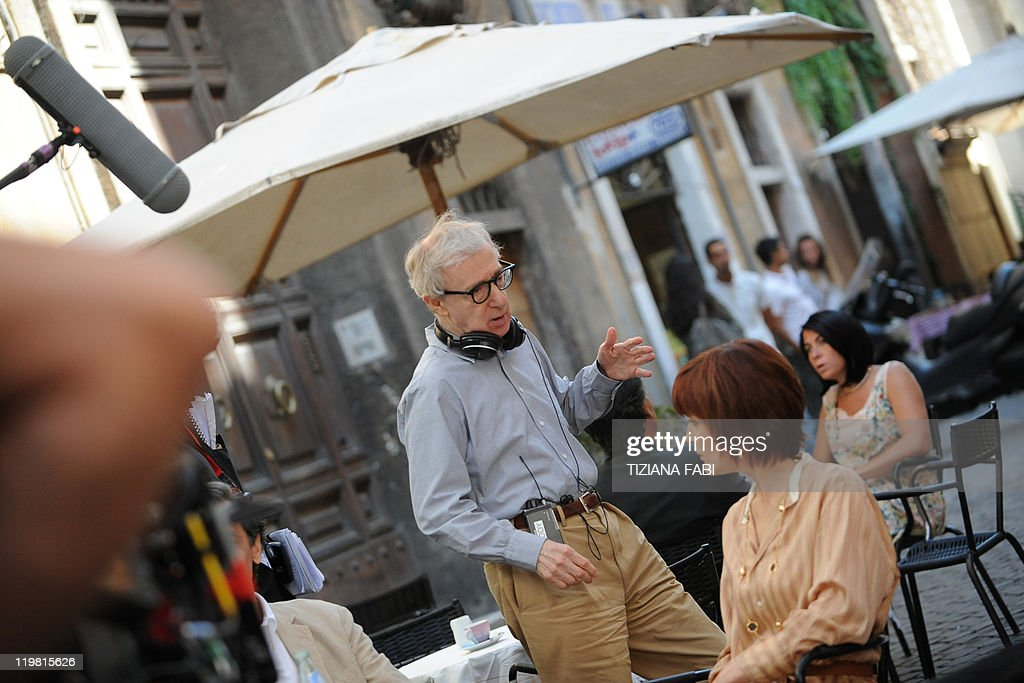 US film director Woody Allen speaks to actors at Piazza della Pace in central Rome during the filming of his new movie The Bop Decameron on July 25...