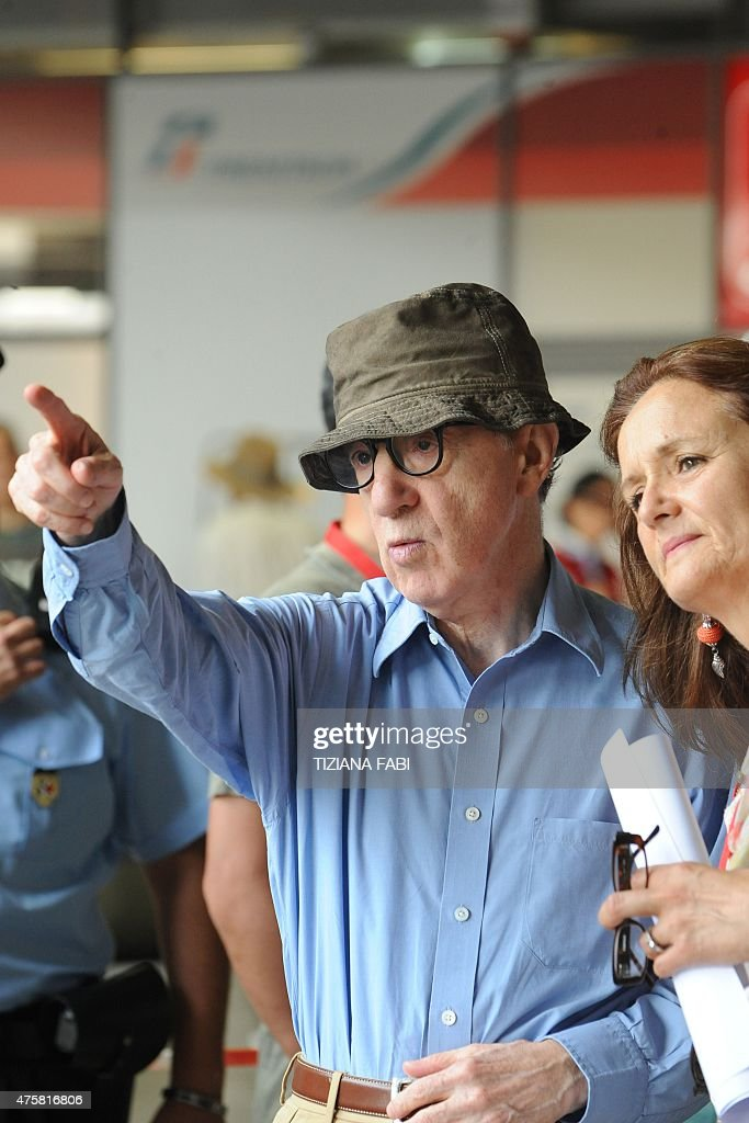 US film director Woody Allen speaks to an assistant on the set of his new film The Bop Decameron at Rome's Termini train station on July 14 2011 The...