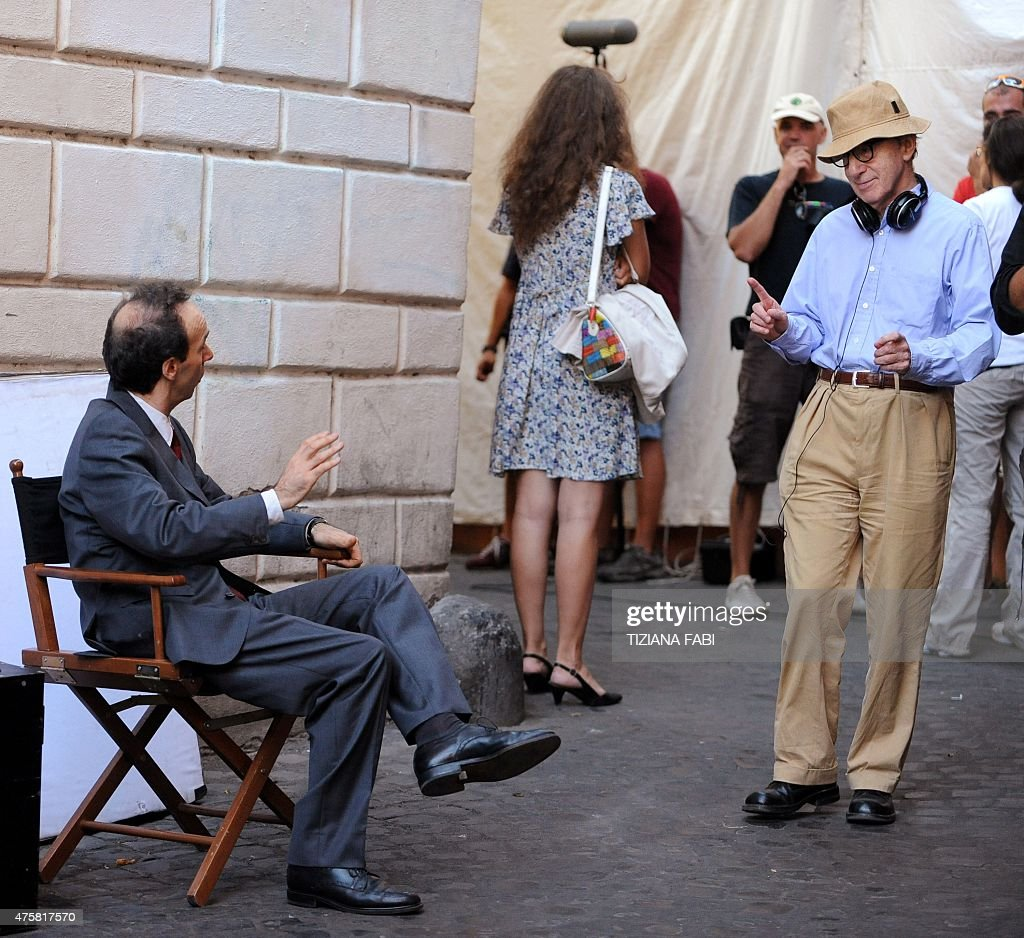 US film director Woody Allen speaks to Italian actordirector Roberto Benigni on the set of 'Bop Decameron' at StMaria in Trastevere square in central...