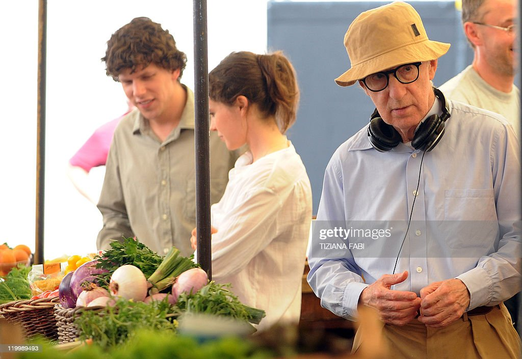US film director Woody Allen stands near US actor Jesse Eisenberg and Canadian actress Ellen Page on the set of 'Bop Decameron' the cult filmmaker's...