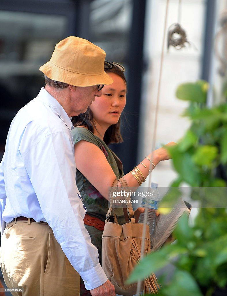 US film director Woody Allen talks to his wife SoonYi Previn on the set of his latest production 'Bop Decameron' at Campo de' Fiori square in central...