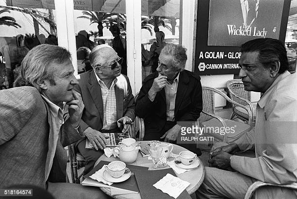 Film directors British John Boorman American Billy Wilder Italian Michelangelo Antonioni and Indian Satyajit Ray have a coffee 14 May 1982 during the...