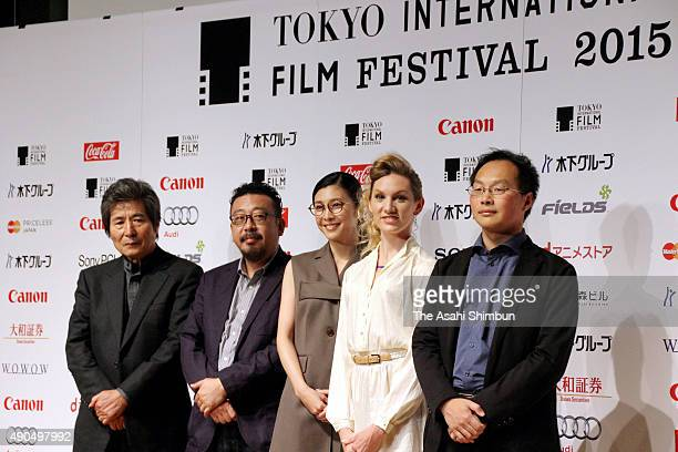 Film directors Kohei Oguri and Yoshihiro Nakamura actresses Yuko Takeuchi and Bryerly Long and film director Koji Fukuda pose for photographs during...