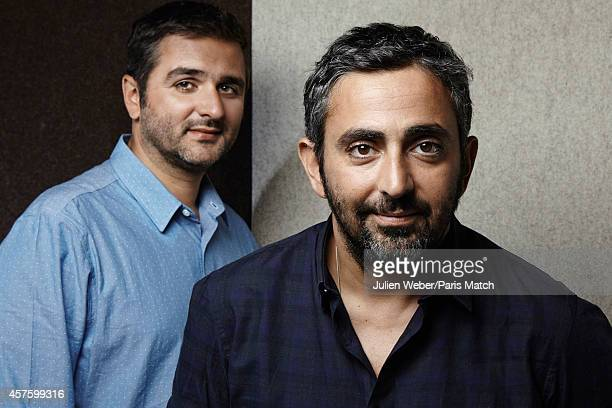 Film directors Olivier Nakache and Eric Toledano are photographed for Paris Match on September 24 2014 in Paris France