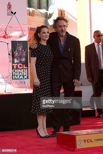 Film directot producer and writer Tim Burton hugging two time Oscar nominee Winona Ryder during his imprint ceremony in the forecourt of the TLC...