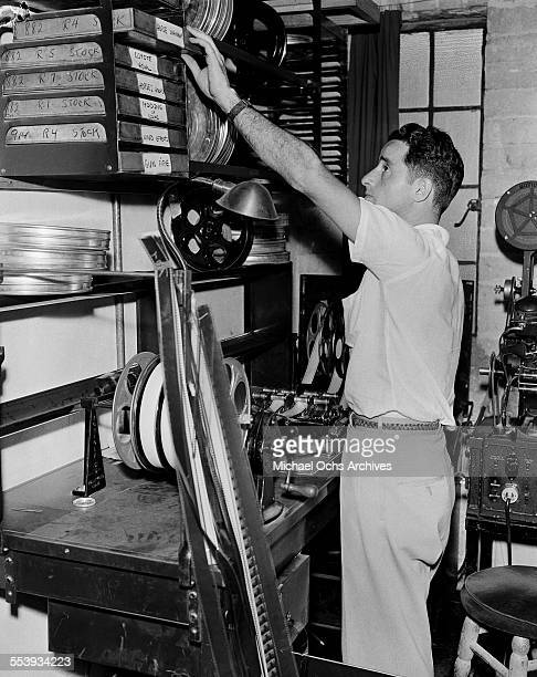 A film editor for Republic Pictures reaches for stock footage in Los Angeles California