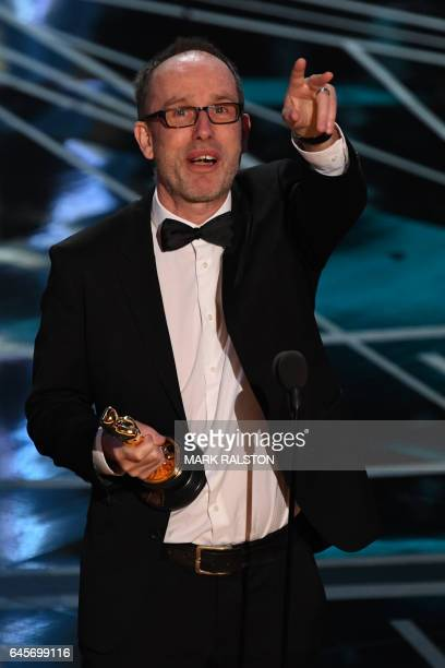 Film editor John Gilbert delivers a speech on stage aftre he won the Best Film Editing award for 'Hacksaw Ridge' at the 89th Oscars on February 26...