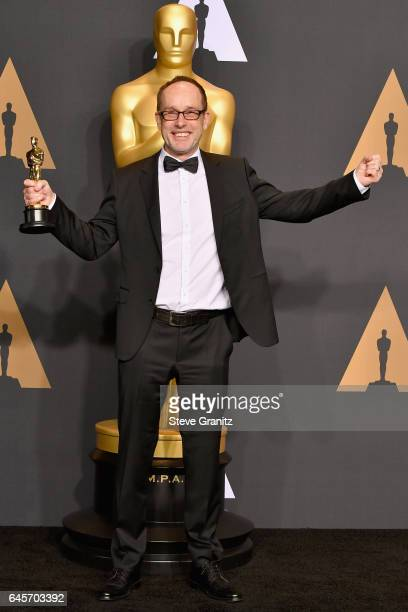 Film editor John Gilbert winner of the award for Editing for 'Hacksaw Ridge' poses in the press room during the 89th Annual Academy Awards at...
