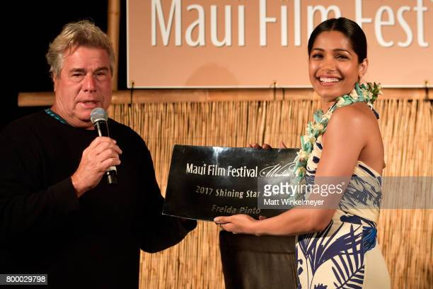 Film Festival founder Barry Rivers presents Freida Pinto the Shining Star Award during the 'Celestial Cinema' on day two of the 2017 Maui Film...