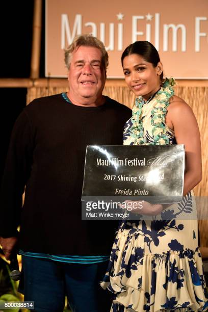 Film Festival founder Barry Rivers presents Freida Pinto the Shining Star Award during the 'Celestial Cinema' on day 2 of the 2017 Maui Film Festival...