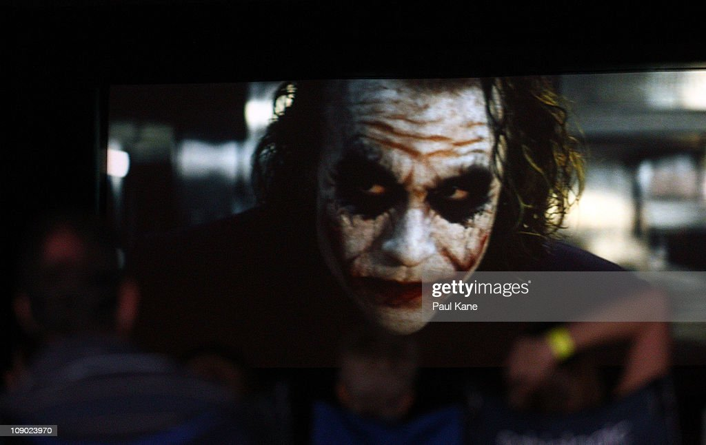 Film goers watch The Dark Knight featuring Heath Ledger during a public tribute outdoor movie night to the late actor at Burswood Park on February 12...