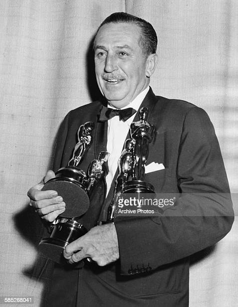 Film maker Walt Disney holding his four Oscars for four different films at the 26th Academy Awards March 25th 1954