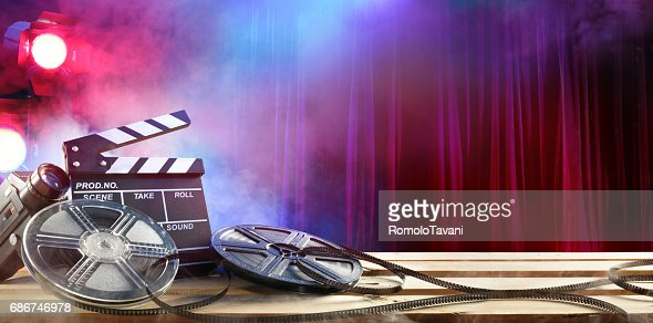 Film Movie Background Clapperboard And Film Reels In Theatre Stock