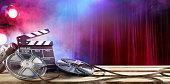 Film Slate And Rolls Of Filmstreep And Spotlights