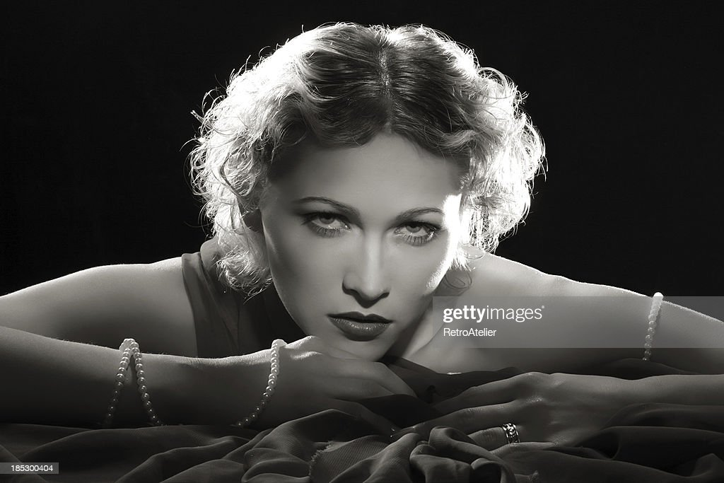 Film Noir Style.Diva with necklace : Stock Photo